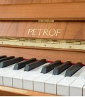 Photo detail of the keyboard and logo of the Upright Piano Petrof P125 F1