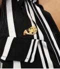 Photo of the Pin Ortolá 7775 FTP007 Horn Golden in a shirt